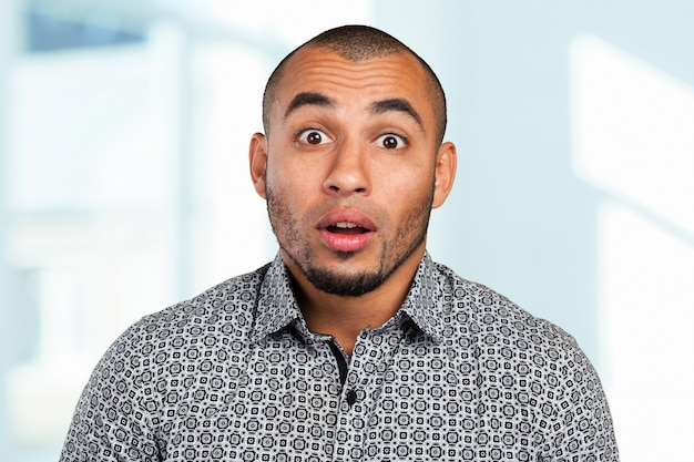 Mixed race male looking in shock
