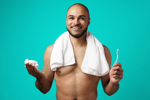 Mixed-race man with towel