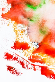 Mixed red and green watercolor brush stroke on white background