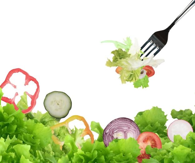 フォークで食べるミックスサラダ。ウェルネスコンセプトのための健康食品