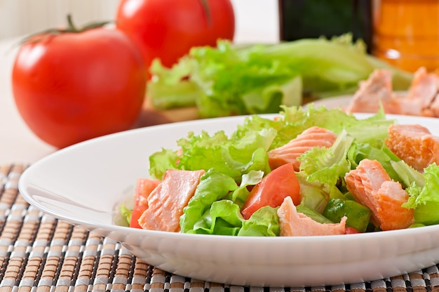 Mixed salad of fresh vegetables with pieces of salmon