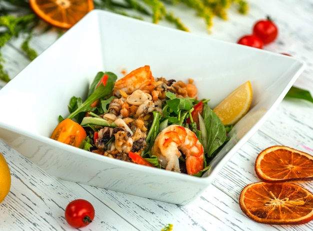 Mixed salad with mushrooms and shrimps