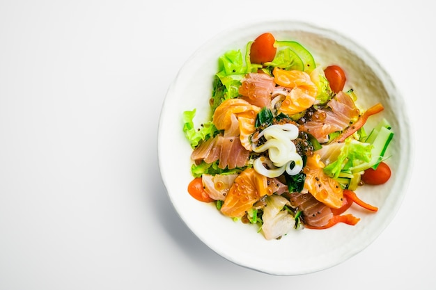 Mixed seafood salad with salmon tuna squid and other fish