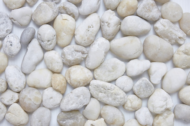 Mixed size of round pebbles stone from sea beach background texture