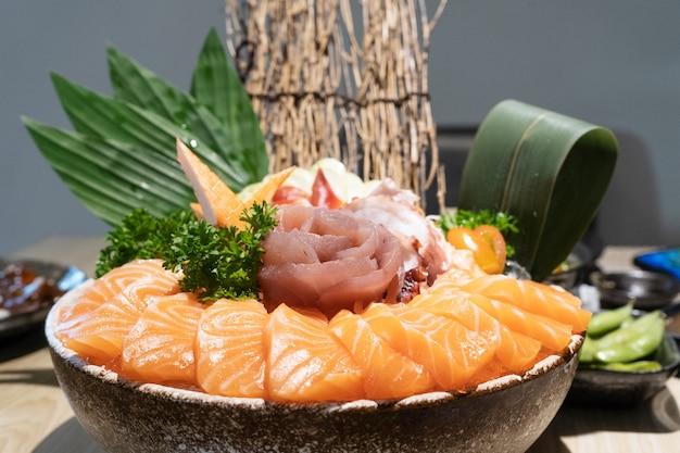 Mixed sliced sashimi on ice, japanese food in asian restaurant
