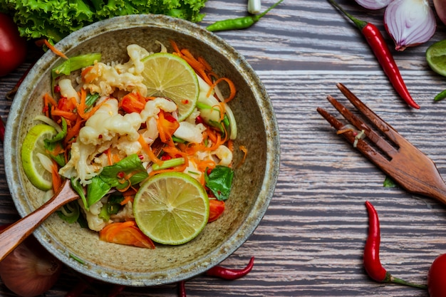 Mixed vegetable and chicken feet , thai spicy salad.