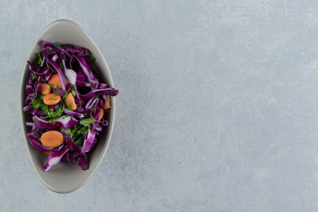 Mixed vegetables in bowl , on the marble background.