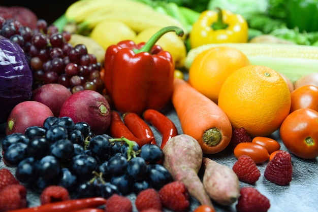 Mixed vegetables and fruits background healthy food clean eating for health - assorted fresh ripe fruit red yellow and green vegetables market harvesting agricultural products