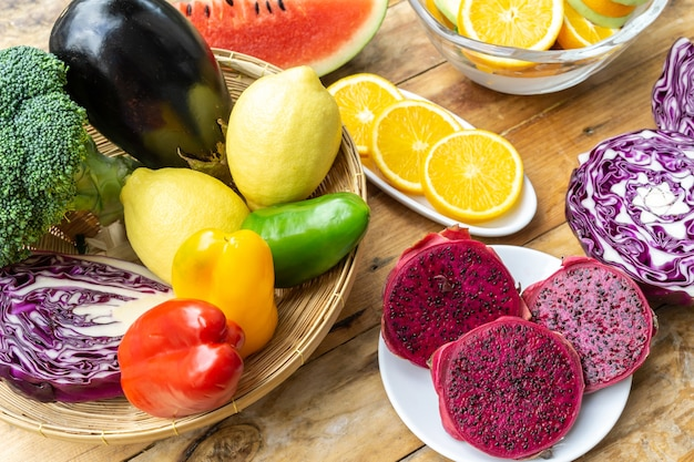 Mixed vegetables and fruits healthy diet food on wood table