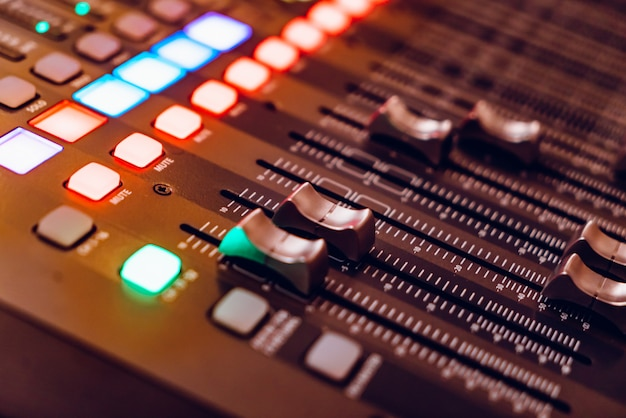 Mixing console for recording with faders and bright buttons