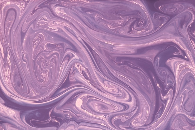 Mixing purple and pink paint abstract background