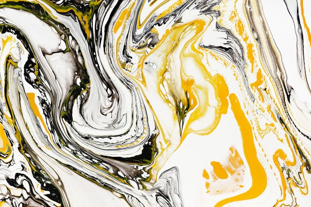 Mixture of acrylic paints modern artwork yellow and black mixed acrylic paints liquid marble texture applicable for design packaging labels business cards and interactive web backgrounds