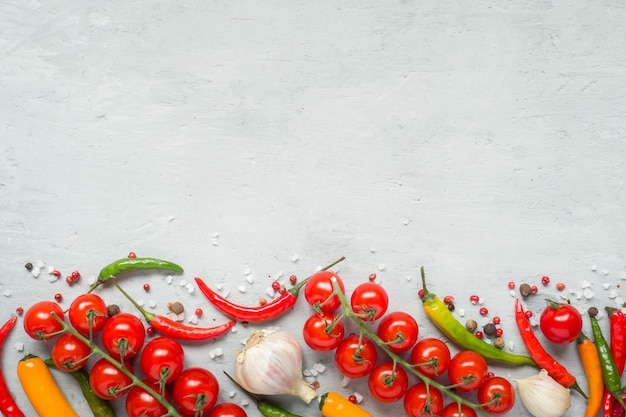 Mixture of chili pepper cherry tomato on a branch garlic and other spices. copy space