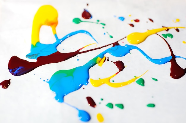 Mixture of colored paints close-up
