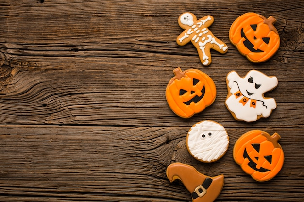 Mixture of halloween stickers on wooden background