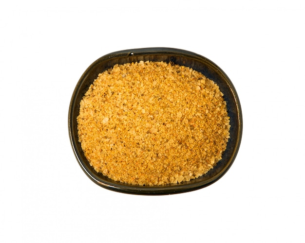 A mixture of seasonings in a bowl on a white background.