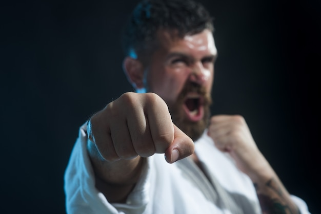 Mma mixed martial art selective focus on fist portrait of screaming handsome male mixed martial arts