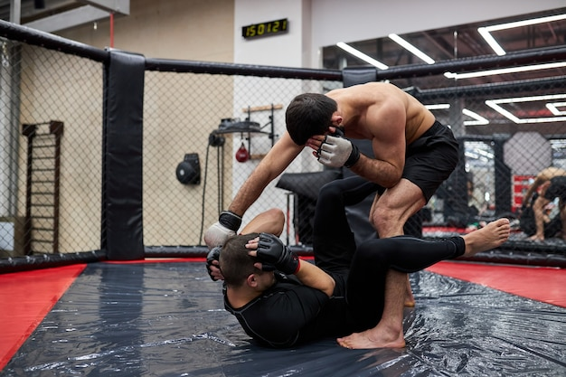 Mma. two professional boxers boxing, fit muscular caucasian athletes fighting. sport, competition, excitement and human emotions concept