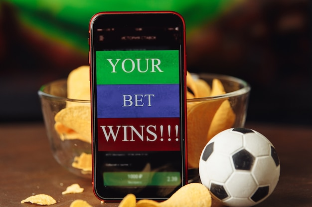 Mobile app for online betting and soccer ball with snacks gambling concept
