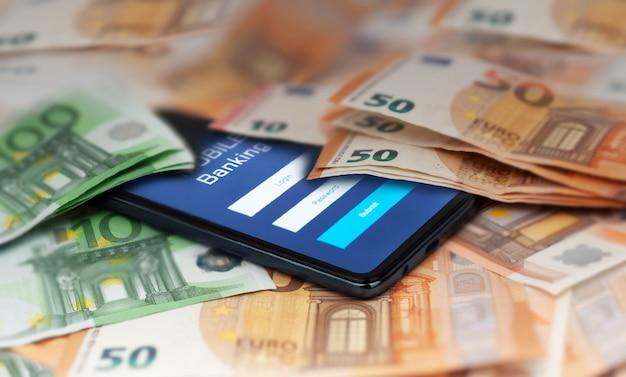 証券取引所市場アプリケーションユーロと米ドルを備えたモバイルバンキングスマートフォン