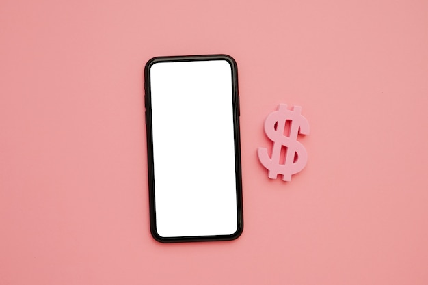 Mobile phone and american dollar symbol, money and technology flatlay