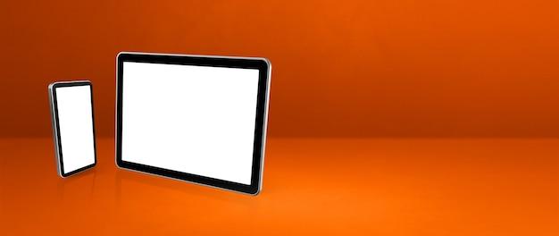 Мобильный телефон и цифровой планшетный пк на оранжевом офисном столе