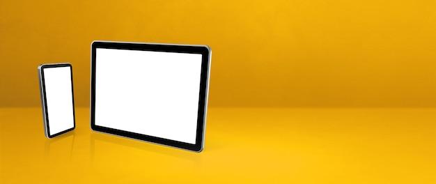 Мобильный телефон и цифровой планшетный пк на желтом офисном столе.