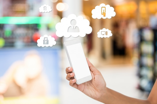 Mobile phone and clouds with application icons