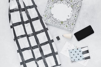 Mobile phone, fabric and wallet with directional map on background