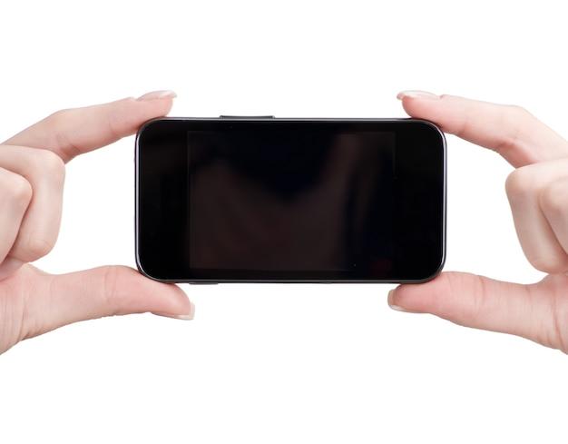 여성의 손에 휴대 전화 프리미엄 사진