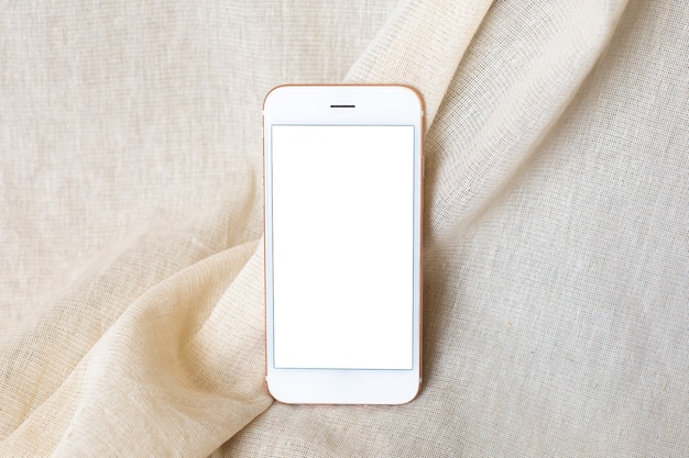 ベージュの天然コットン生地の携帯電話。