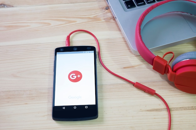 Mobile phone opened google plus application.