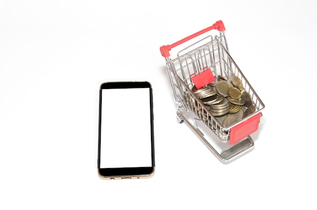 Mobile phone screen with coins in the tiny shopping cart