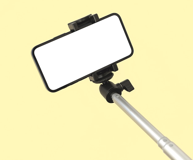Mobile phone and selfie stick mockup for travel and fashion, beauty template colorful pastel background, copy space photo