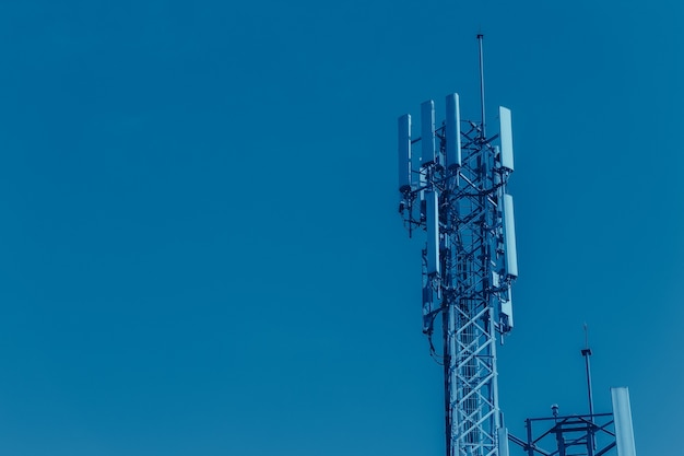 Mobile phone signal tower cell site of digital 4g antenna blue color tone for high technology communication system with space for text