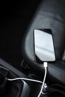 Mobile phone, smartphone charge battery , charging in the car plug close up