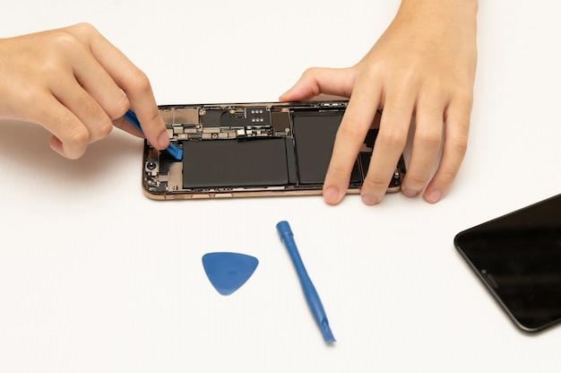 Mobile phone or smartphone repair technician