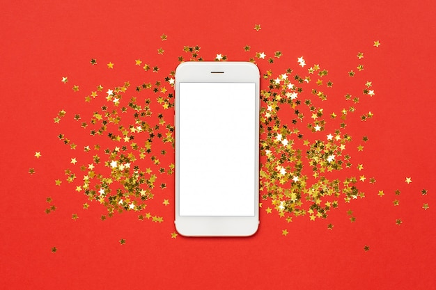 Mobile phone with golden stars confetti