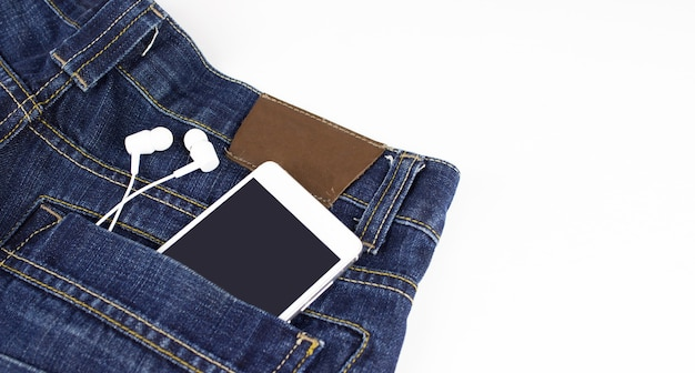 Mobile phone with headphone in your back pocket jeans.