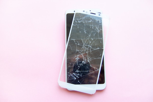 Mobile smartphone with broken glasstouch screen isolated. service, repair, technology and minimalism concept.