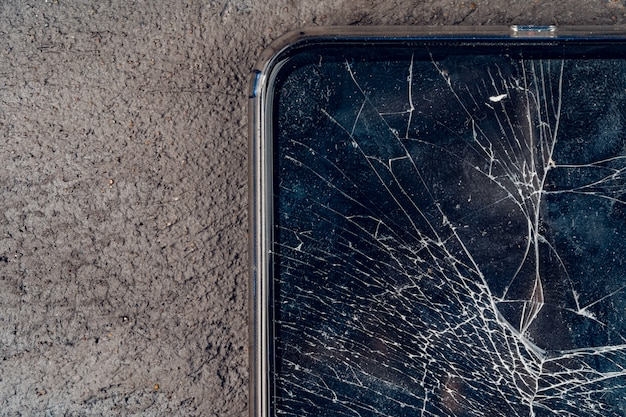 Mobile smartphone with broken screen close up
