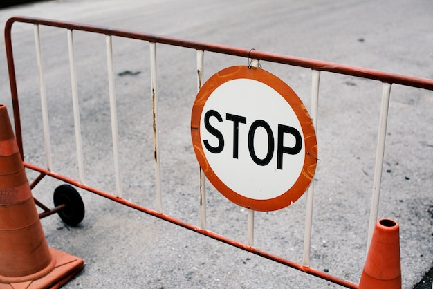 Mobile steel barrier fence with stop sign