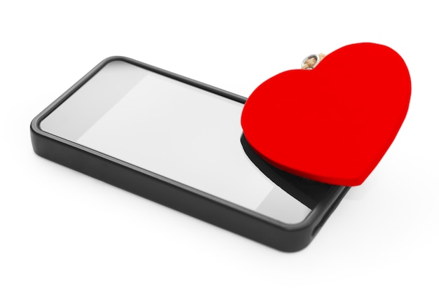 Mobile with red heart. love concept