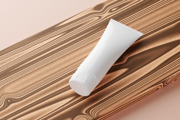 Косметическая трубка mocap лежит на деревянном столе. 3d визуализация. Premium Фотографии