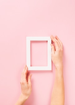 Mock up and background frame or posters with hand on pink