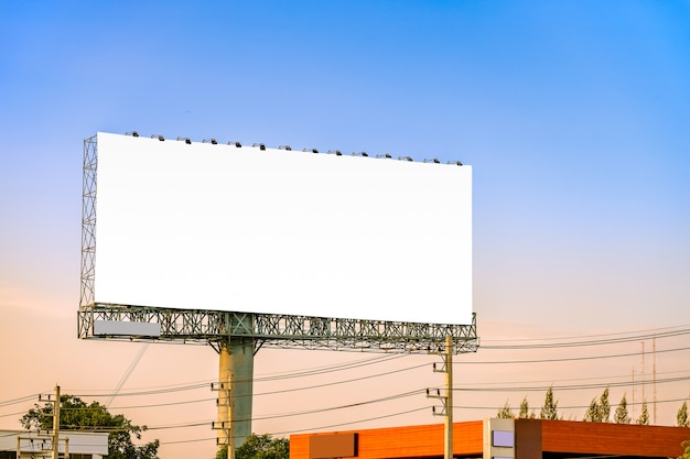 Mock up billboard canvas in city background with beautiful sunset.