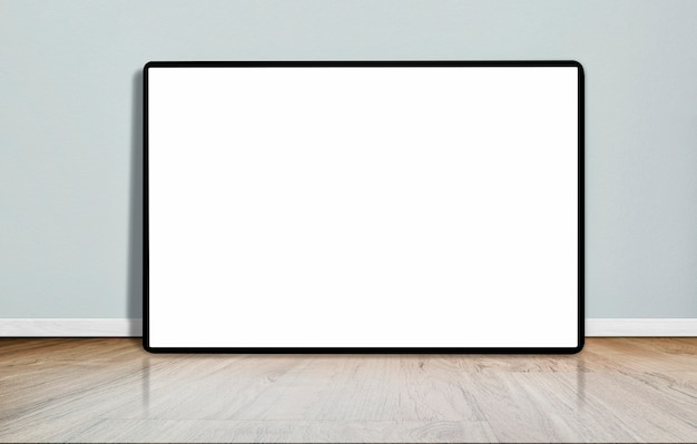 Mock up blank picture frame on wooden floor in empty room with concrete wall.