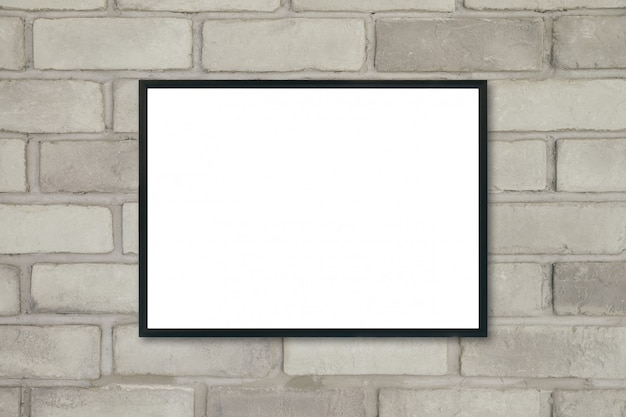 Mock up blank poster picture frame on brick wall.