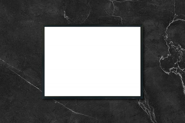 Mock up blank poster picture frame hanging on black marble wall in room - can be used mockup for montage products display and design key visual layout.