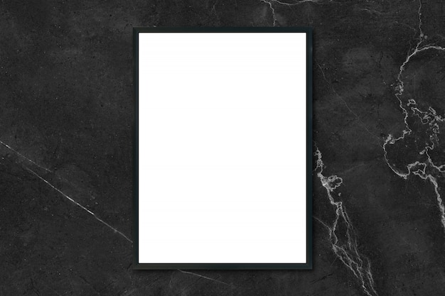 Mock up blank poster picture frame hanging on black marble wall in room